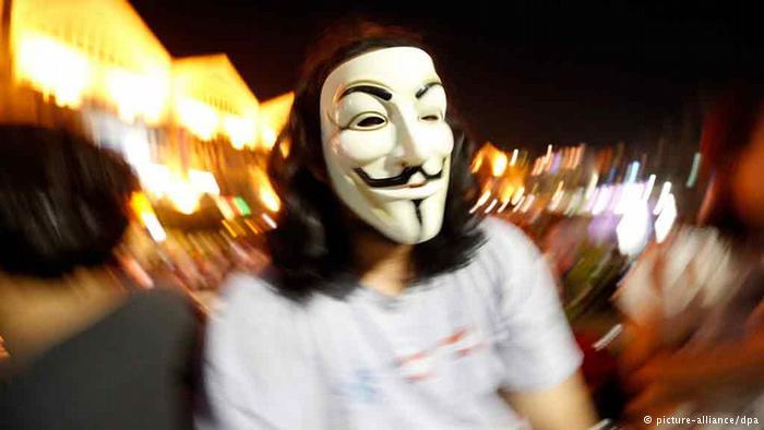 Man wearing V for Vendetta Guy Fawkes Mask