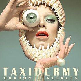 """The new album of Sharon Needles is all about the one-eye sign. Before I get a comment saying """"Sharon Needles is a transgender hero who needs to be applauded at all times"""", I say: """"Check out this next pic""""."""