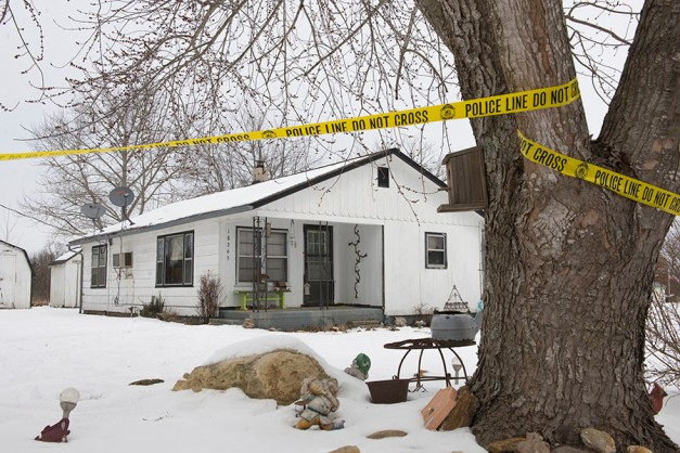Police tape surrounds one of the crime scenes where gunman, Joseph Jesse Aldridge, killed seven people on Thursday night in Tyrone, Missouri February 27, 2015. ©Kate Munsch