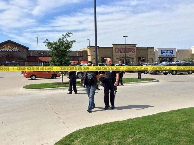 Police escort a man at the scene of a shooting in Waco, Texas, in this handout photo provided by the Waco Police Department on May 17, 2015. ©/Waco Police Department