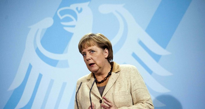 German Chancellor Angela Merkel in front of Germany's heraldic eagle