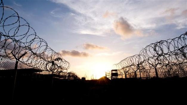 "The razor wire-topped fence and a watch tower at the abandoned ""Camp X-Ray"" detention facility at the US Naval Station at Guantanamo Bay, Cuba, April 9, 2014. (AFP photo)"