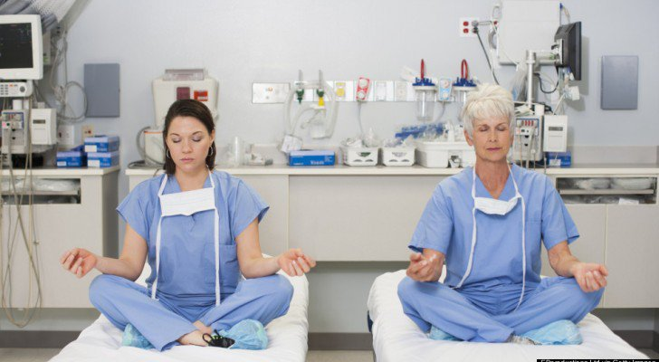 Caucasian surgeons meditating on hospital beds