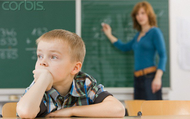 Distracted Student in Classroom --- Image by © Wolfgang Flamisch/Corbis