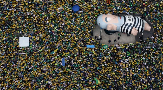 "An inflatable doll known as ""Pixuleco"" of Brazil's former President Luiz Inacio Lula da Silva is seen during a protest against Rousseff, part of nationwide protests calling for her impeachment, in Sao Paulo, Brazil, March 13, 2016. © Paulo Whitaker"