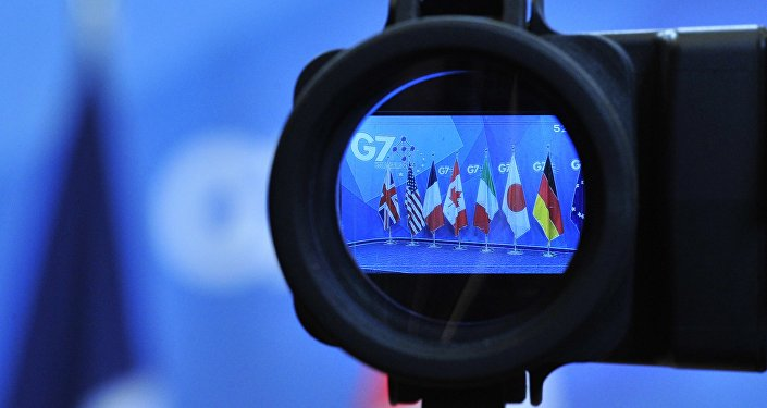Flags are seen in a camera screen at the G7 summit (file)