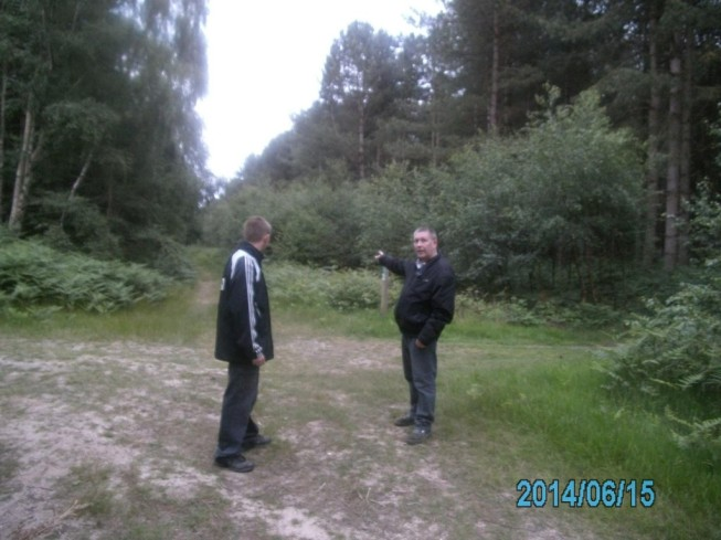 Derek and his Son in Rendlesham pointing towards a part of the Forest that they witnessed a rather strange portal like sighting (please see below).