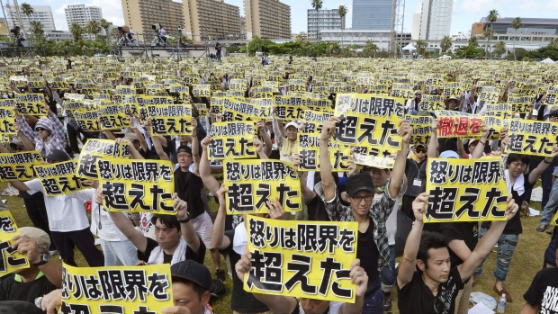 "Protesters hold placards that read: ""Our anger has reached its limit"" during a protest rally against the presence of U.S. military bases on the southwestern Japanese island of Okinawa in Naha on Sunday."