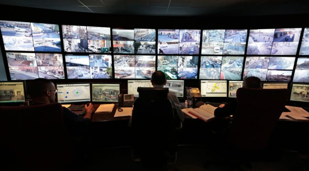 Municipal police officers watch screens in the video surveillance control room of the municipal police supervision centre in Nice © Eric Gaillard
