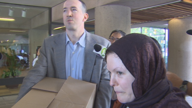 John Nuttall and Amada Korody face media cameras outside B.C. Supreme Court July 29 after their terrorism convictions were overturned.