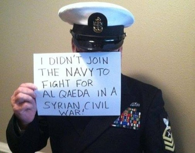 This photo, posted on Facebook wall under the name of RallyPoints, stirred up controversy and debate as to whether a person should done a military uniform when making a political statement. Pictured is a man saying he is a chief petty officer and doesn't want to go to war with Syria.<br>