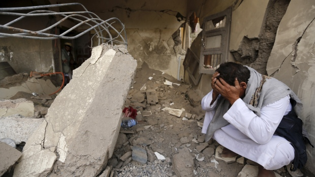 A man who lost his relatives in a Saudi-led airstrike cries in Yemen's capital Sanaa on Sept. 21, 2015. Canada has sold Saudi Arabia billions of dollars' worth of light-armoured vehicles and has had little to say about its customer's attacks in Yemen, which the UN says have killed and wounded hundreds of children.