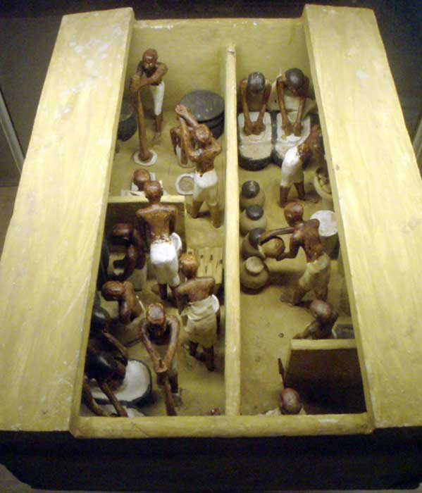 An Egyptian funerary model of a bakery and brewery.