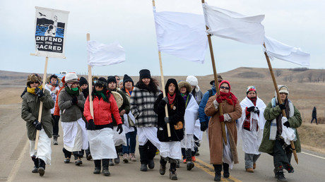 Women march to Backwater Bridge during a protest against plans to pass the Dakota Access pipeline near the Standing Rock Indian Reservation, near Cannon Ball, North Dakota, U.S. November 27, 2016. © Stephanie Keith