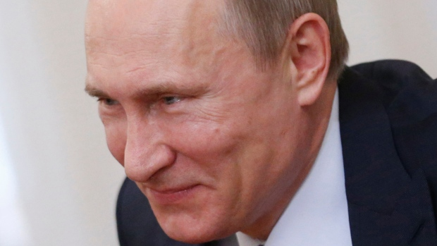 Russian President Vladimir Putin smiles during a meeting with Ben van Beurden, chief executive officer of Royal Dutch Shell, in 2014. Putin's response to U.S. President Barack Obama's latest sanctions is 'an incredible chess move,' says analyst Lauren Goodrich.