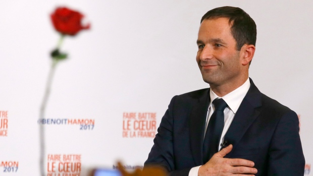 Benoît Hamon greets supporters after winning the Socialist Party presidential nomination in Paris on Sunday. Partial count shows Hamon beating former French prime minister Manuel Valls.