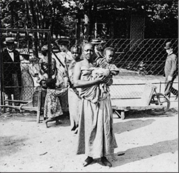 """Human zoos existed 16 Depressing Photos That Will Destroy Your Faith In Humanity - A """"Negro Village"""" in Germany displaying a mother and her child."""