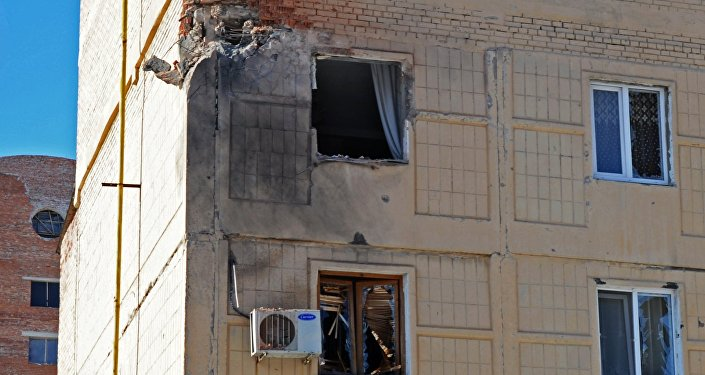 Shattered windows in a residential building in Donetsk, damaged during a shelling by the Ukrainian military