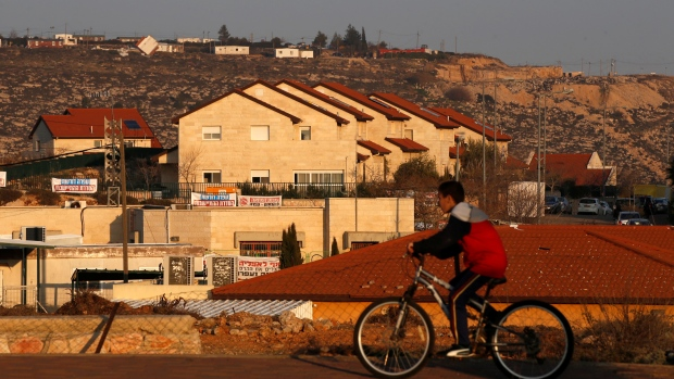 The Israeli parliament passed a contentious law on Monday meant to retroactively legalize thousands of West Bank settlement homes built unlawfully on private Palestinian land.