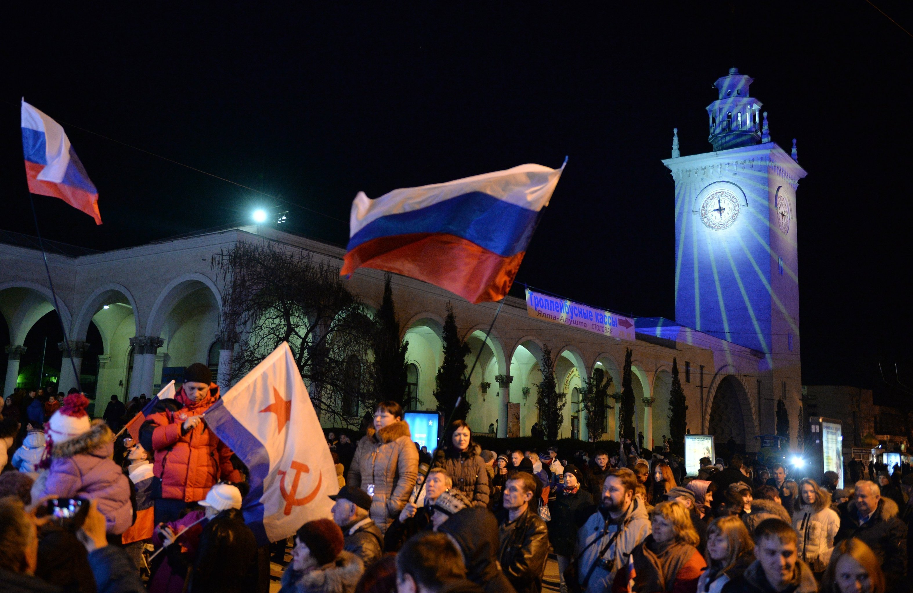 Crimean residents at the railway station in Simferopol marking a holiday as clocks are moved to Moscow time