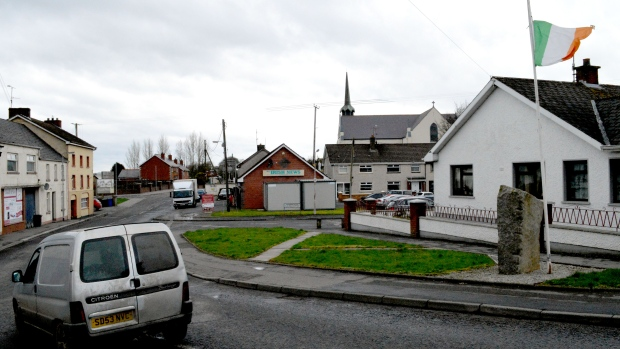 The Irish flag flies at half-mast in the village of Crossmaglen, Northern Ireland, to mark the passing last week of Martin McGuinness, a nationalist political leader and former IRA member. With Brexit underway, there is talk of reuniting Ireland to keep the north in the European Union.