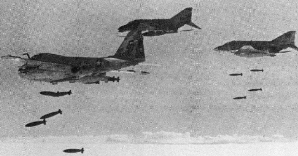 U.S. fighter jets and an attack plane drop bombs on Cambodia circa 1973.