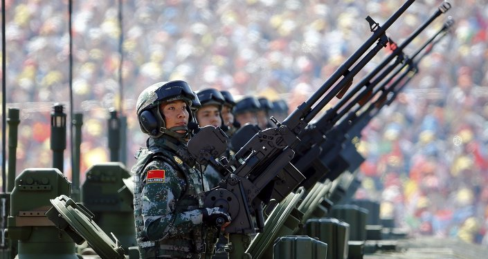 Soldiers of the People's Liberation Army (PLA) of China arrive on their armoured vehicles at Tiananmen Square during the military parade marking the 70th anniversary of the end of World War Two, in Beijing, China, September 3, 2015