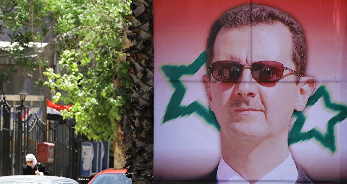 Poster bearing a portrait of President Bashar al-Assad