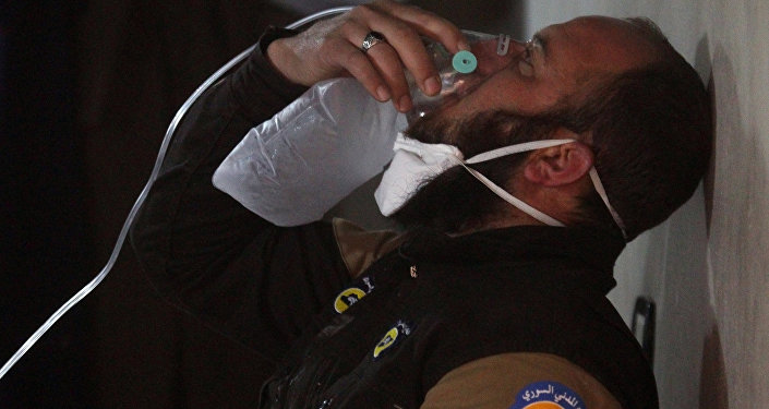 A civil defence member breathes through an oxygen mask, after what rescue workers described as a suspected gas attack in the town of Khan Sheikhoun in rebel-held Idlib, Syria April 4, 2017.