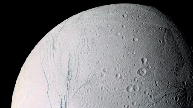 The surface of Saturn's moon Enceladus, as seen in 2007. Scientists have found food on that moon that they say could sustain potential life.