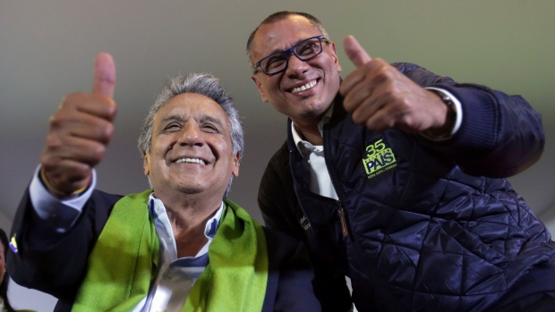 Alianza PAIS's presidential candidate Lenin Moreno, left, and his running mate Jorge Glas smile at the end of the day of the presidential election, in Quito on Sunday.