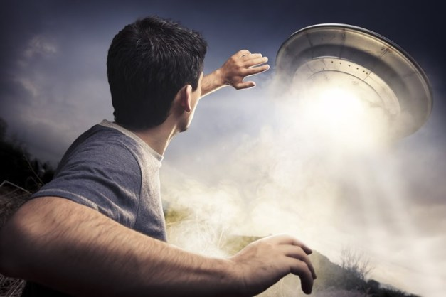 Image shows a man and a flying saucer.