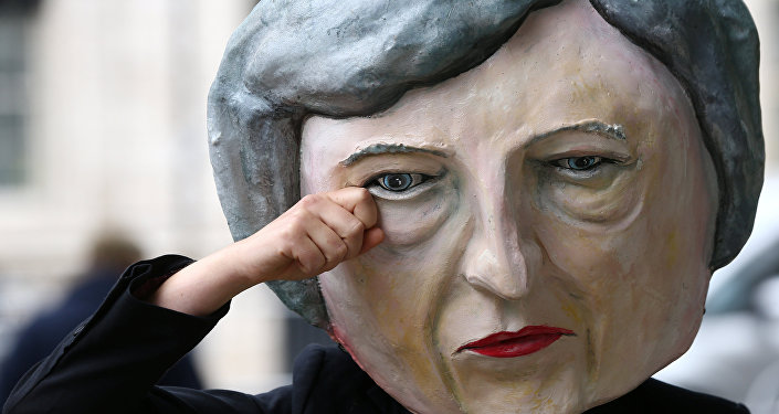 Protestor wearing a Theresa May mask poses outside Downing Street after Britain's election in London, Britain June 9, 2017.