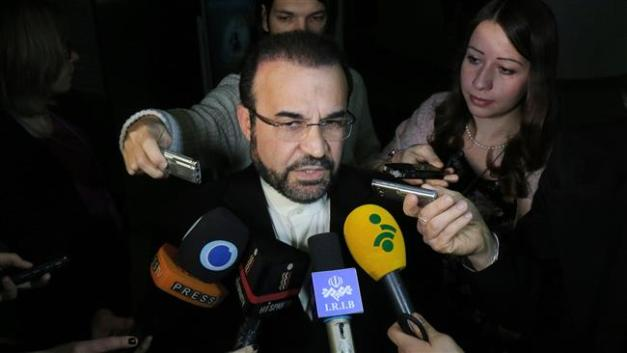 Iran's Ambassador to the IAEA Reza Najafi speaking to reporters (Photo by AP)