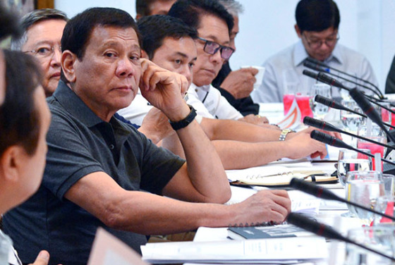 In this photo provided by the Presidential Communications Operations Office, Philippine President Rodrigo Duterte listens during a special cabinet meeting in Davao city, southern Philippines, Thursday, May 25, 2017. Duterte declared 60 days of martial law on Tuesday across the southern third of the nation, an area that includes Marawi but extends well beyond it. ISIS-linked militants launched a violent siege in Marawi that sent thousands of people fleeing for their lives and raised fears of extremists gaining traction in the country. Presidential Communications Operations Office via AP