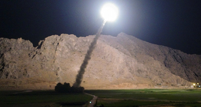 In this picture released by the Iranian state-run IRIB News Agency on Monday, June 19, 2017, a missile is fired from city of Kermanshah in western Iran targeting the Islamic State group in Syria