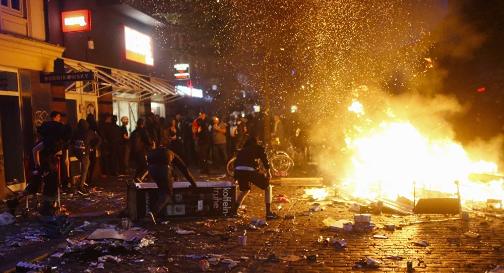 Barricades burn as protesters clash with riot police during the protests at the G20 summit in Hamburg, Germany, July 7, 2017