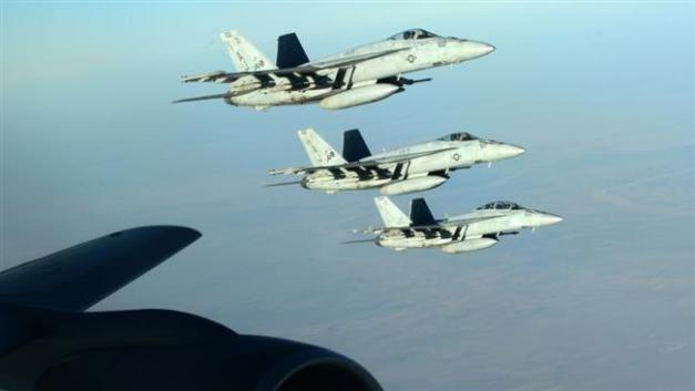 US Navy F-18E Super Hornets fly over northern Iraq as part of the US-led coalition airstrikes against Takfiri Daesh terrorist group and other targets on September 23, 2014. (Photo by AP)