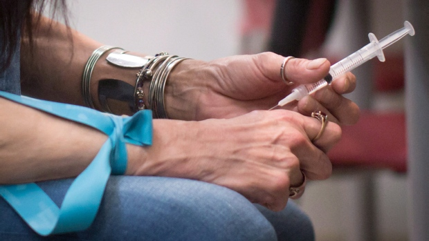 Tracey Loyer injects hydromorphone at the Providence Health Care Crosstown Clinic in the Downtown Eastside of Vancouver, B.C., on Wednesday April 6, 2016. A Vancouver study suggests severely addicted heroin users could be treated with an injectable pain medication.