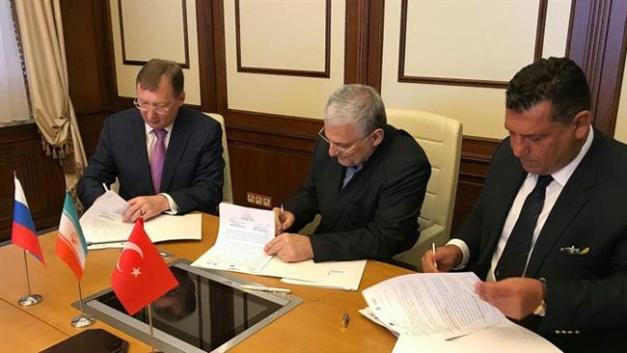 Representatives of Iran's Ghadir, Russia's Zarubezhneft and Turkey's Unit International sign documents for investment partnership in oil and gas projects in Moscow, Aug. 8, 2017.