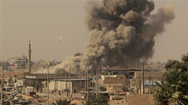 Smoke rises after a US-led airstrike during fighting between members of the so-called Syrian Democratic Forces and Daesh terrorists in Raqqah, Syria, on August 15, 2017. (Photo by Reuters)