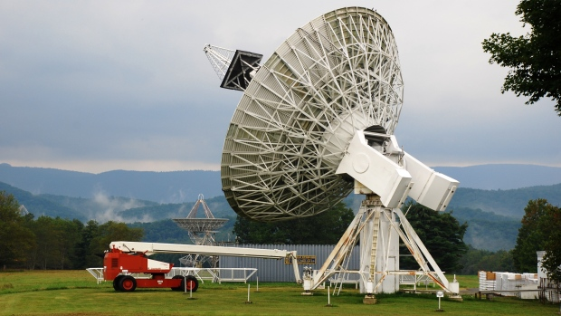 The 14-metre telescope at National Radio Astronomy Observatory in Green Bank, W.Va. Using radio telescopes from the Green Bank installation, astronomers have detected 15 fast radio bursts emanating from a distant galaxy.