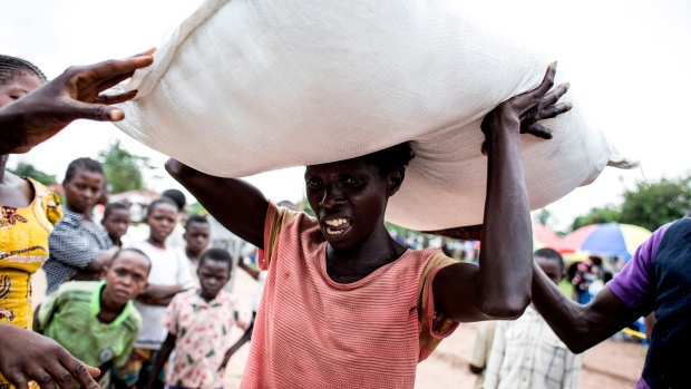 A woman in the region of Kasai, Congo, carries a sack of food at a distribution centre. Conflict in the Kasai provinces has displaced 1.5 million people. As three crop cycles have been missed and displacement continues, severe malnutrition is becoming a pressing issue.