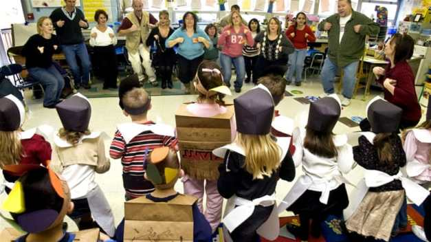 "Kindergarten students, dressed as pilgrims and Native Americans, show their parents and grandparents how to do the ""Mr Turkey Gobble"" in Danville, PA on November 20, 2008 [AP Photo/Bill Hughes]"