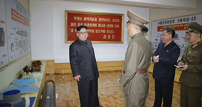 In this image made from video of a news bulletin aired by North Korea's KRT on Wednesday, Aug. 23, 2017, leader Kim Jong Un visits the Chemical Material Institute of Academy of Defense Science at an undisclosed location in North Korea. North Korea's state media released photos that appear to show concept diagrams of the missiles hanging on a wall behind leader Kim Jong Un, one showing a diagram for a missile called Pukguksong-3. Independent journalists were not given access to cover the event depicted in this photo.