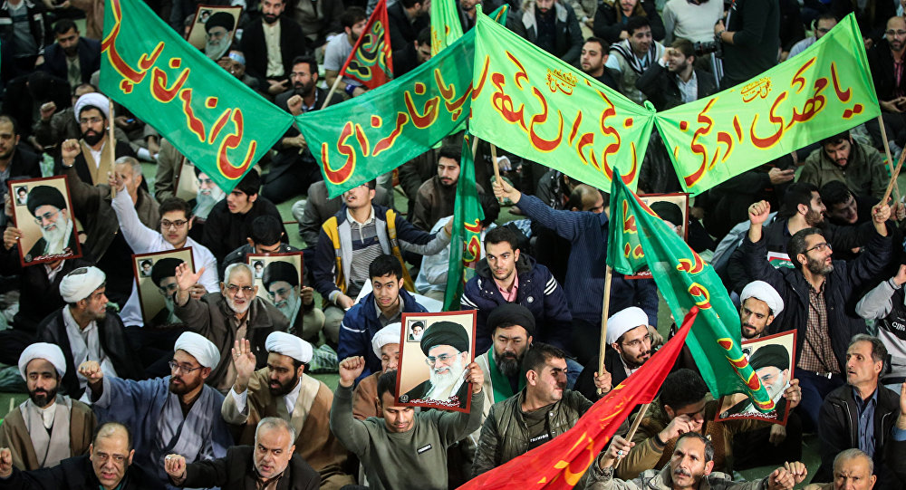 Iranians chant slogans as they march in support of the government near the Imam Khomeini grand mosque in the capital Tehran on December 30, 2017