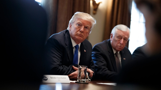 U.S. President Donald Trump listens during a meeting with lawmakers on immigration policy in the White House, on Tuesday.