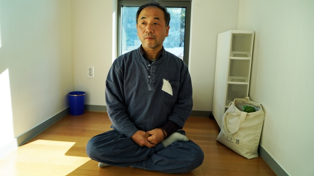 Autoparts engineer Suk-won Kang, 57, sits in one of the 28 cells at Prison Inside Me, a jail-themed stress-reduction centre in the mountain town of Hongcheon, about two hours northeast of Seoul.