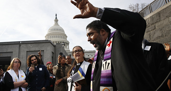Rev. William Barber II, with the Poor People's Campaign, speaks to the group after they prayed inside of the Capitol Rotunda in protest of the GOP tax overhaul, Monday, Dec. 4, 2017, on Capitol Hill in Washington.