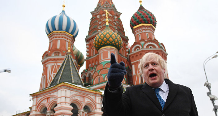 British Foreign Secretary Boris Johnson stands in front of Saint Basil's cathedral in Red square in Moscow on December 22, 2017 after a meeting with his Russian counterpart.